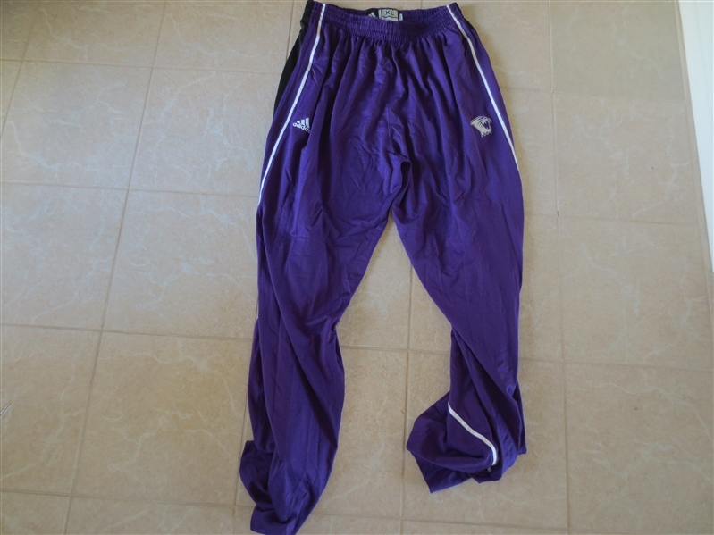 BASKETBALL Assortment of: Game Used Northwestern Wildcats Long Warm up pants, Celtics replica jersey, Globetrotters program